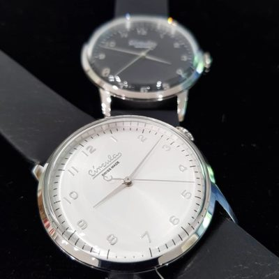 White dial, steel case, black nappa leather band